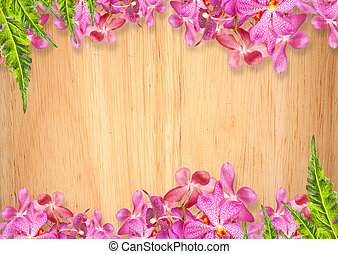 Old wooden background with pink Orchid flowers frame