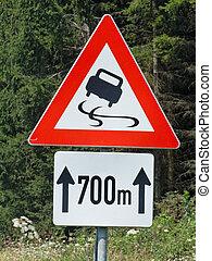 road sign skidding - warning skidding on slippery road