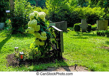 grave stone at cemetery, symbol of death, memory,...