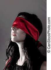 woman with blindfold - a young woman with fastened eyes....