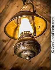 ancient metal lamp - ancient kerosene metal lamp indoors