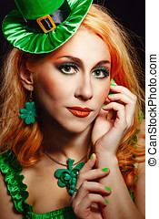 Girl wearing leprechaun - Red hair girl in Saint Patrick's...