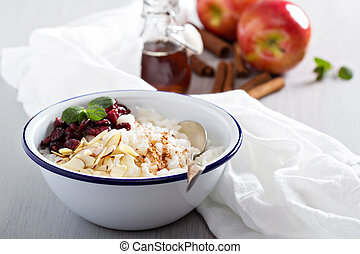 Breakfast rice porridge with almonds and cranberry -...