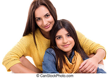 Woman and little girl hugging each other - Family concep