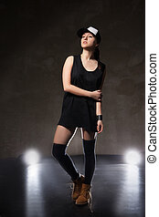 Sexy young woman in a trendy clothes over black background...