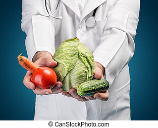 Healthy food concept - Health food concept Doctor holding...