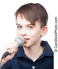 Kid with mic - Cheerful boy holding microphone singing or...