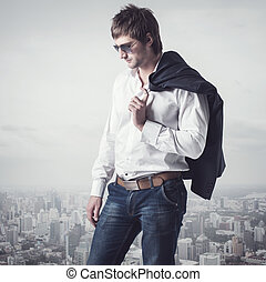 Confident, ambitious good looking man on the top of city...