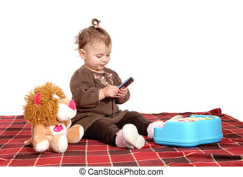 Little baby girl on blanket - A lovely baby girl sitting on...
