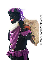 Zwarte Piet with a bag full of presents - Zwarte Piet is a...