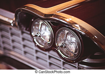 Color detail on the headlight of a vintage car front light