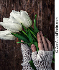 postcard to the eighth of March - female hand with a bouquet...