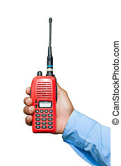 Red portable radio transceiver in hand isolated on white
