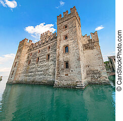 Sirmione castle on Lake Garda, Italy - Rocca Scaligera is a...