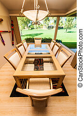 Dinning room table set with large window