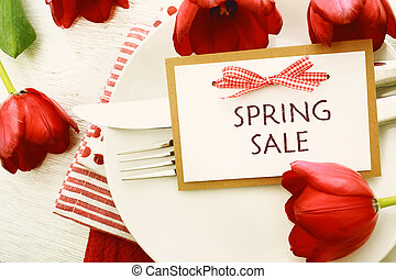 Dinner table setting with Spring Sale message