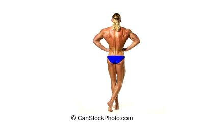 Bodybuilder posing over white background.
