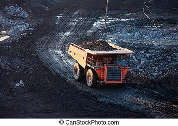 coal-preparation plant. Big mining truck at work site coal trans