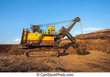 coal-preparation plant. Big yellow mining truck at work site coa