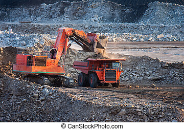 big mining truck unload coal - LAMPANG, THAILAND - DEC 29:...