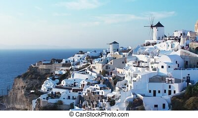 Classic Santorini scene with famous blue dome churches,...