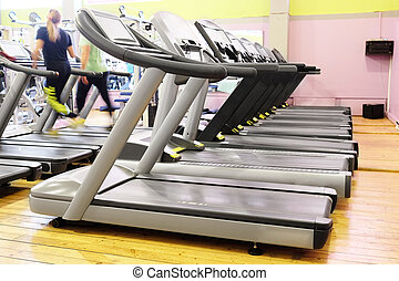 treadmills - Set of treadmills staying in line in the gym