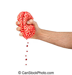 Hand squeezes a rubber brain, metaphor of the concept...