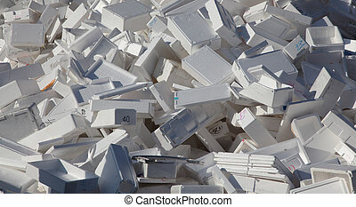A large pile of styrofoam boxes disgarded as rubbish