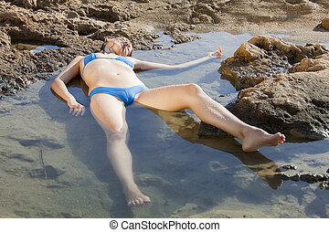 unconscious woman in water - model playing a drowning woman...