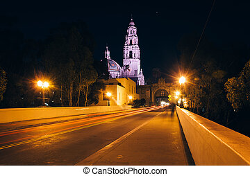 The Cabrillo Bridge and San Diego Museum of Man at night, in...