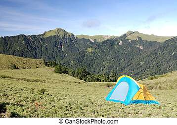 tent in the mountain .