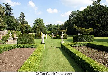garden with topiary trees and statues