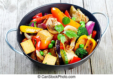 Healthy snack of roast vegetables and tofu