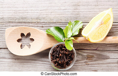 Decorative wooden spoon with cloves and lemon - Overhead...