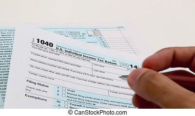 Income tax form and pen Finance concept over a white...