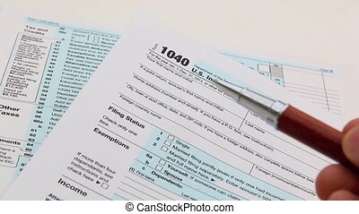 Income tax form and pen Finance concept 1040 form