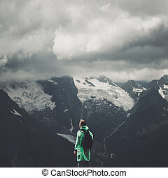 male traveller and summer mountain stormy landscape - male...