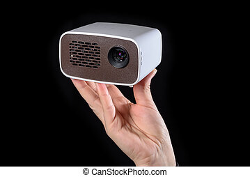 Minibeamer held in the hand - Mini projector held in the...