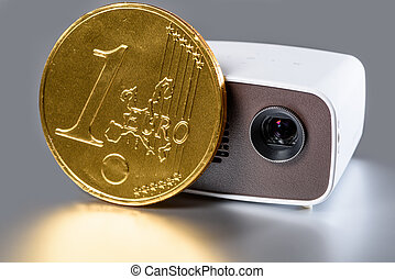 Mini Projector with golden euro coin for size comparison...