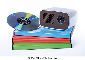 Mini Projector with DVD on DVD cases isolated on white...