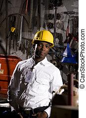 Worker in office maintenance room