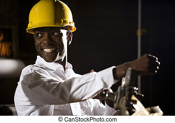 Close up of African American man wearing a hard hat