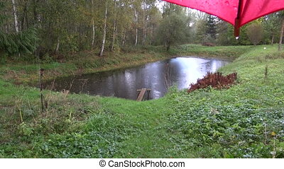 pond in farm and red umbrella