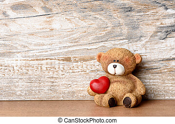 Little bear with heart under his arm as Valentines Day...
