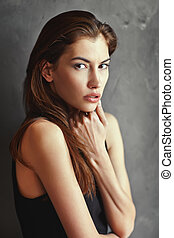 dramatic portrait of passion young woman
