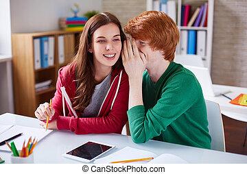 Telling secret - Handsome guy whispering his girlfriend...