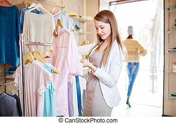 Pretty consumer - Beautiful young woman shopping