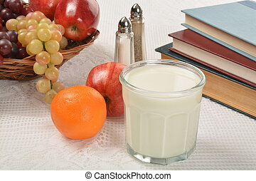 Healthy after schol snack - A glas of milk with fruit with...