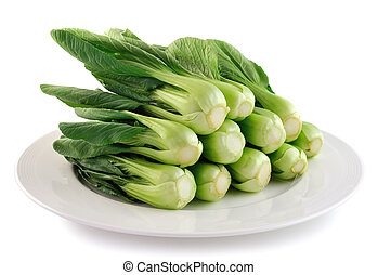Bok choy chinese cabbage on white plate