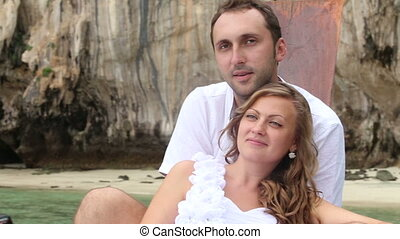 bride and groom sitting on longtail boat - blonde bride and...